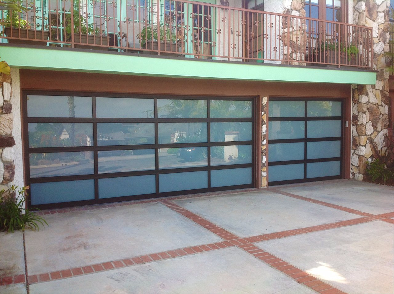 Amarr vista full view aluminum glass garage doors on trac garage these modern sleek garage doors perfectly mirror the clean lines and glass expanses of your homes contemporary design available in a variety of glass rubansaba