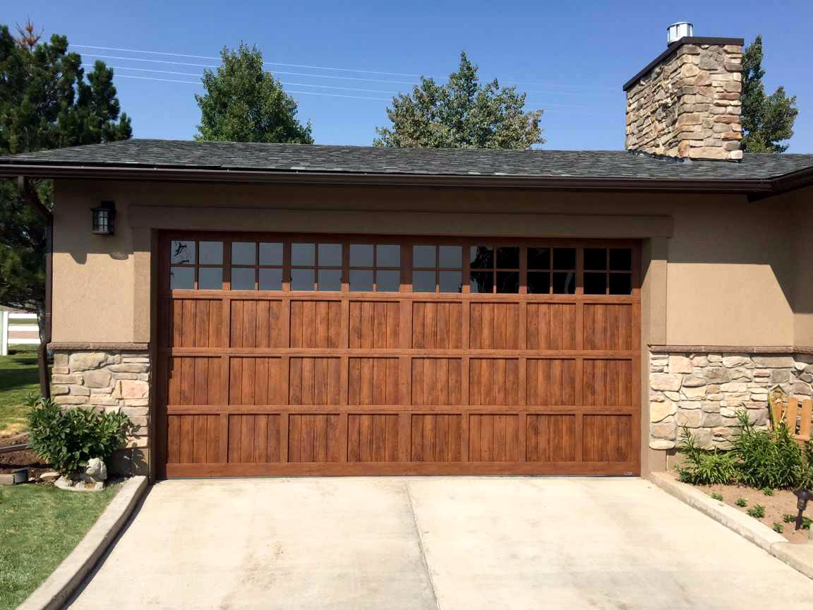 Martin pinnacle garage doors on trac garage doors now available with v groove panels this door is like nothing youve ever seen woodgrain available in steel only rubansaba