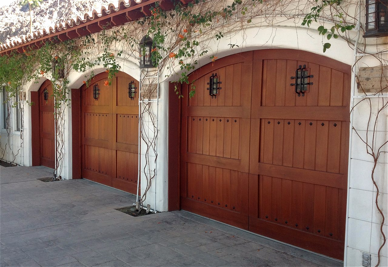 Amarr classica carriage house garage doors on trac garage doors contemporary or something else a beautiful custom wood garage door will take the look of your home to a whole new level if you can dream it we can rubansaba